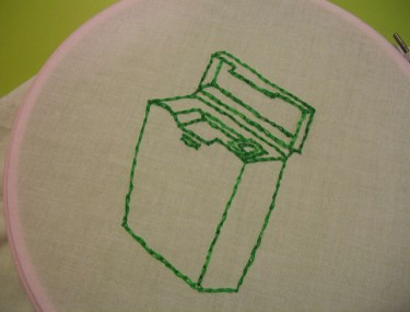 dental floss embroidered in green