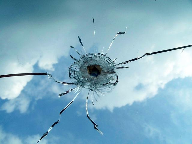 bullet hole in mirror