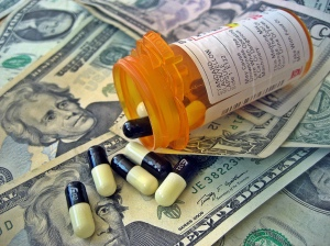 pill bottle and money