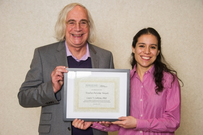 Leonard Fleck and Laura Cabrera hold the Teacher-Scholar award