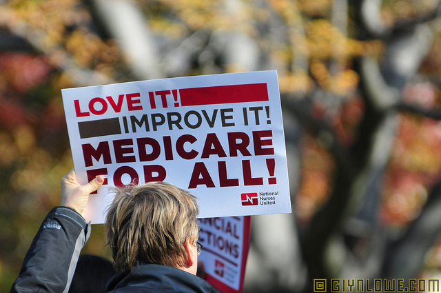 Individual holding Medicare For All sign